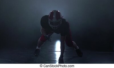 Offensive lineman ready to attack. Slow motion