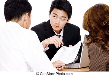 Offering Advice - An advisor points out important parts of a...