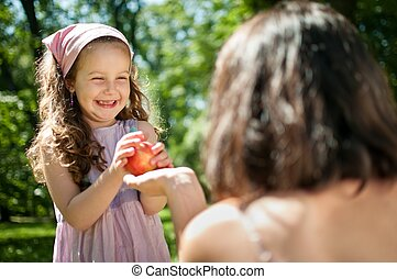 Offering apple - mother with child