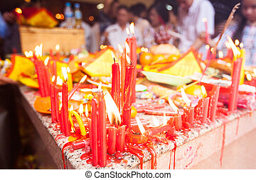 Incense stick fire and food course for offering god with