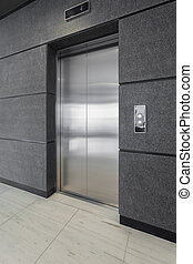 Office adapted to clients using wheelchair - Elevator in...