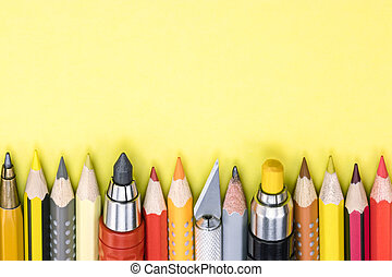 office and school supplies on yellow background