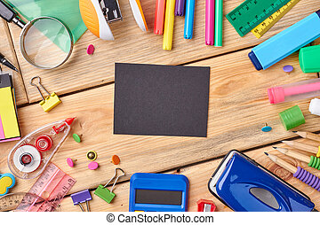 Office and student accessories on wooden background.