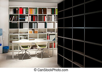 Office area with lot of books and table