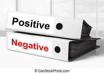 office binders positive negative - stack of two white office...