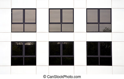 Office block - Six windows in an office block of a white...