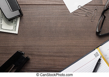office brown wooden table with pen glasses and notebook background