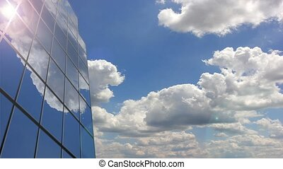 Office building cloud reflection. Time lapse
