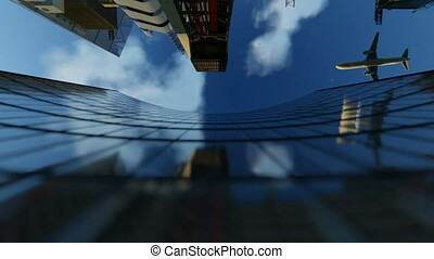 Office building facade and aircraft passing against blue...