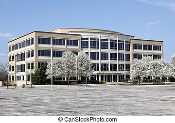 Office building with blooming trees in spring
