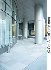 Office building lobby with glass windows and columns
