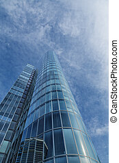 office building. modern glass silhouette of skyscraper with dramatic sky.