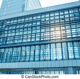 office building with blue glass wall detail