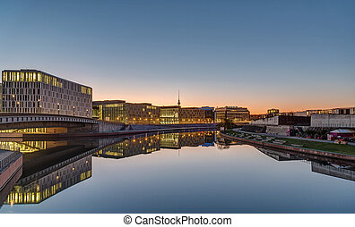 Office buildings at the river Spree in Berlin at dawn