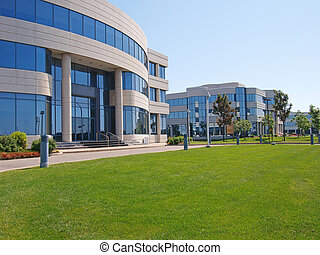 row of office buildings with grass in front