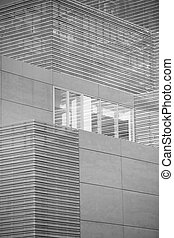 Office buildings with modern corporate architecture - business and success concept, blue sky, windows. Black and white image.