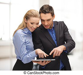 office, buisness, education, technology concept - man and woman with tablet pc