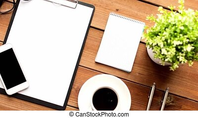 clipboard, smartphone, cup of coffee and notebook - office, ...