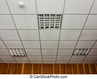 White office ceiling with built-in fluorescent lamps