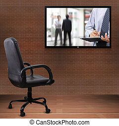 Office chair and TV screen