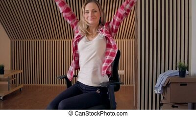 Office chair race. Slow motion. Young woman have fun in the office during a break.