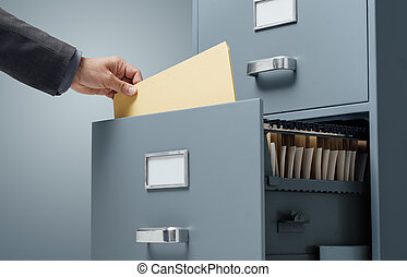 Office clerk searching files