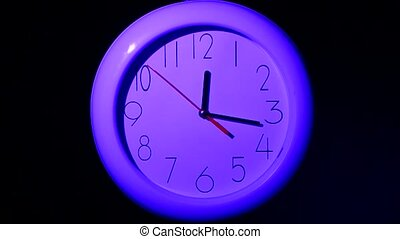 office clock on black background, night