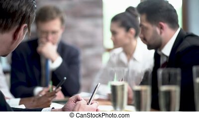 Office colleagues have a discussion on a business meeting -...