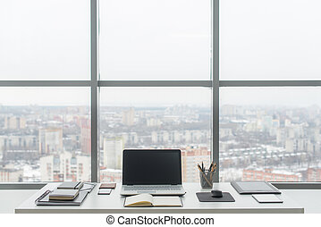 Office. Comfortable work table, workplace with notebook...