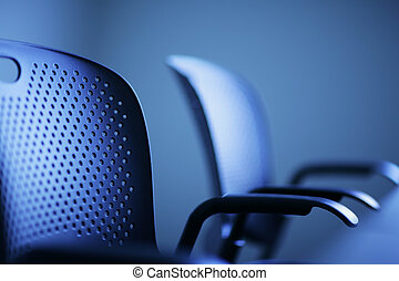 Office concept - Modern office chairs detail, shallow DOF.
