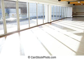 Office corridor. Sunlight.