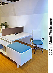 Office cubicle with modern chair and desk furniture
