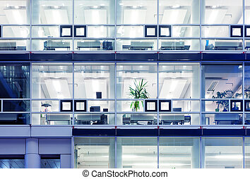 Cubicles in a modern office building. Toned image, illustrating the everyday rut and routine