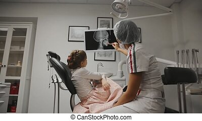 Office dentist orthodontist dentist shows x-ray images of...