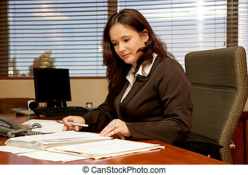 Office Desk - A woman sitting at her desk in a office