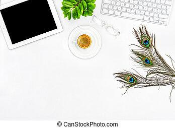Office desk keyboard, tablet pc, coffee, green plant