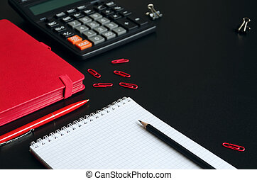 Office desk table with notebook, calculator, pen and pencil