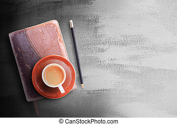 Office desk table with notebook,pencil and coffee cup.