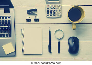 Office desk table with supplies and coffee cup. Top view. Copy space for text