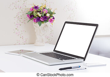 office desk with blank screen laptop computer