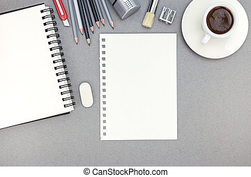 office desk with paper sheet, notepad, pencils and coffee cup, top view
