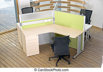 office desks and black chairs cubicle set view from top over wood flooring