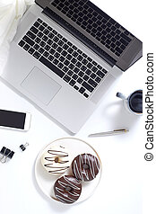 Office desktop with laptop and accessories, top view