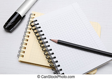 office equipment - two notebooks in a cage and markers and ...