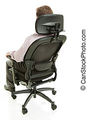 Office Ergonomics - Executive sitting in a fully adjustable...
