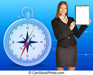 Office girl holding clipboard standing on blue background with compass