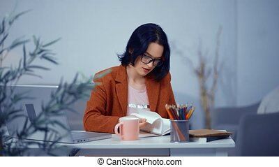 Office Girl is Busy with Everyday Tasks on Workplace. Woman...