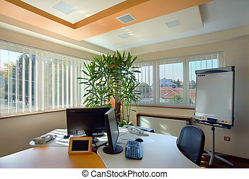 Interior of an office, modern and simple furniture and lighting equipment.
