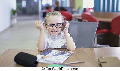 office kid talking on phone