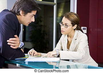 Office life: young salesclerk talking to a customer